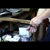 Presenting the knife sharpening process and the final shaping of the blade.